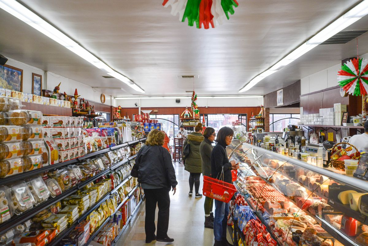 Customers browse an aisle at an Italian market.
