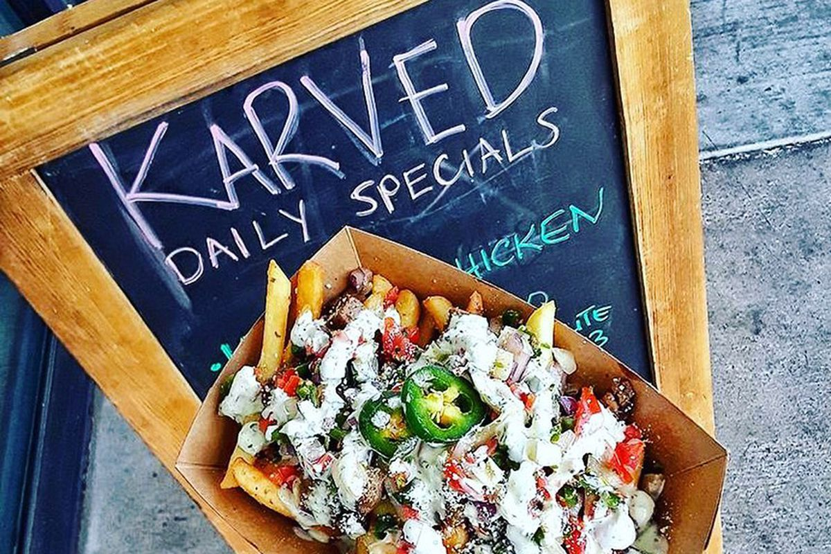 Carne asada fries, on the casual menu at the eatside's Karved restaurant.