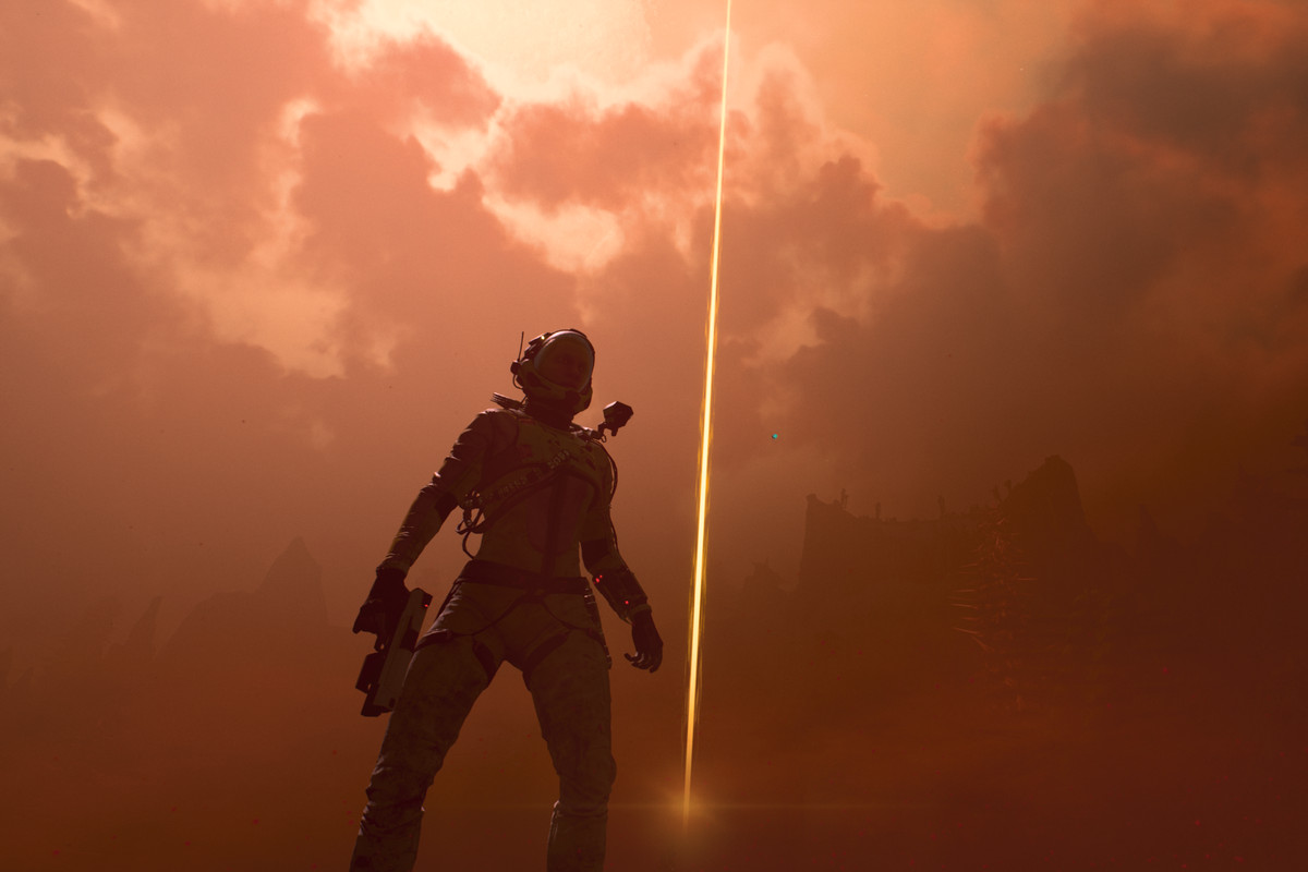 The main character of Returnal stands in a dust storm