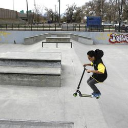 Jason Ledezma, a seventh-grader at Granite Park Junoir High, rides his scooter at Fairmont Skate Park in Salt Lake City on Wednesday, Nov. 21, 2012. Utah lawmakers are pushing to add more physical activity in schools because being active increases brain function, according to a nationwide study called SPARK.