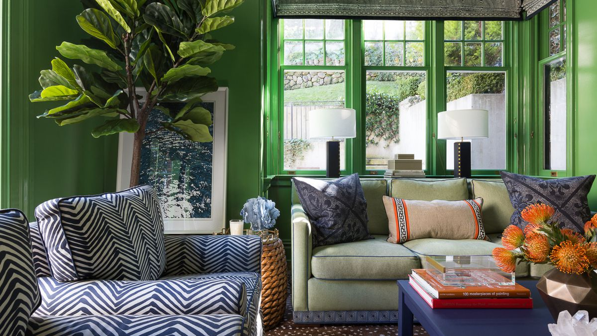 A living room where every bit of every wall is painted green.