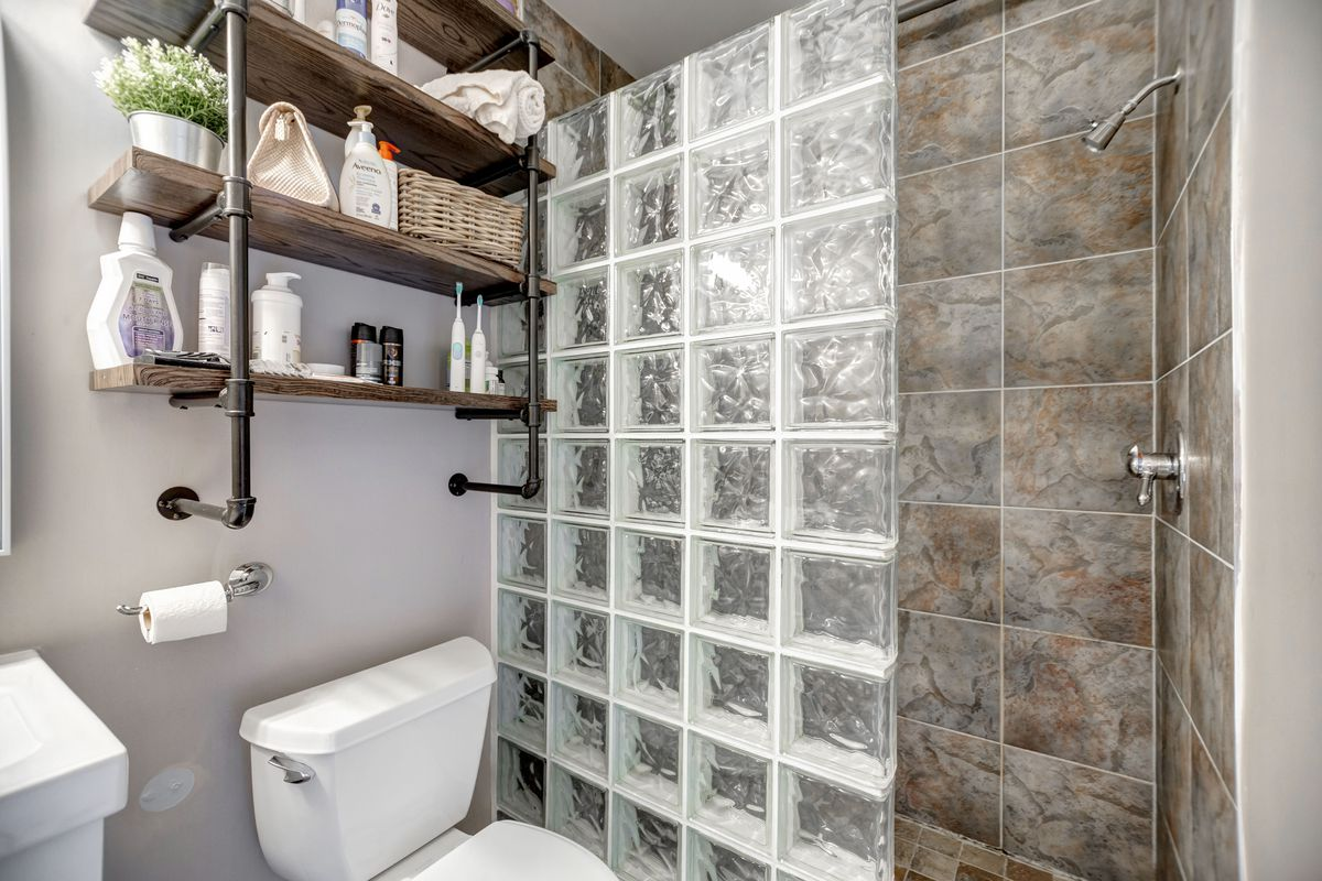 A bathroom with glass-block shower wall.