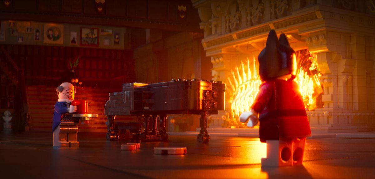 Alfred tries to look after Batman at home in The Lego Batman Movie.