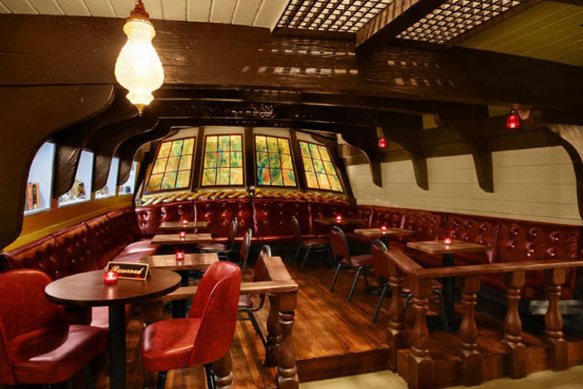 The interior of the Benbow Room in West Seattle, which has dark wood and elements reminiscent of an old sea vessel