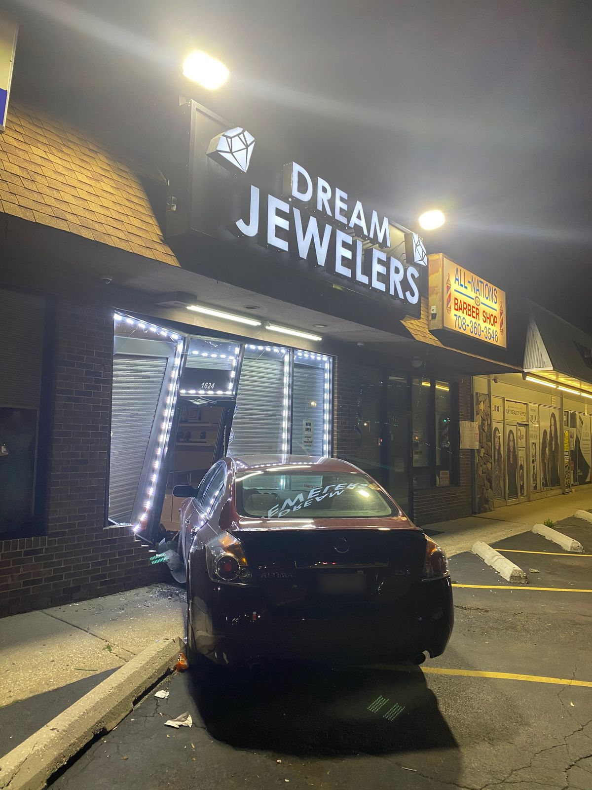 A car is lodged in the storefront of Dream Jewelers, 1624 Sibley Blvd., in Calumet City.
