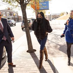 """""""The Real Housewives of Salt Lake City"""" star Jen Shah, center, leaves the U.S. District Court in Salt Lake City on Tuesday, March 30, 2021. Shah, who is married to an assistant football coach at the University of Utah, faces federal fraud charges in New York."""