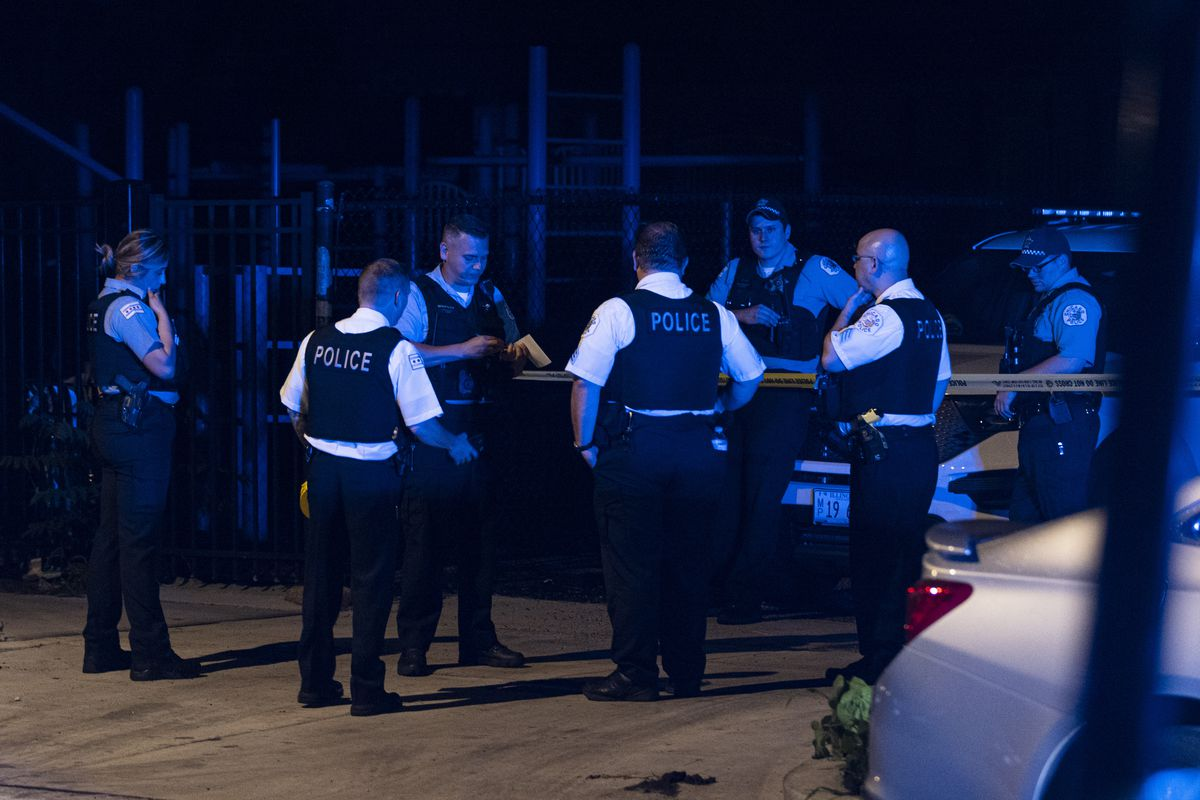 Police investigate the scene where at least four people were shot near 2245 S Millard St in Little Village, Wednesday, June 30, 2021.