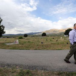 Scott Thomas, Jordan School District administrator, walks through the Bingham City Cemetery in Copperton on Thursday, May 25, 2017. The Jordan School Board has deeded the pioneer cemetery to Copperton Township after 44 years as owner and caretaker.