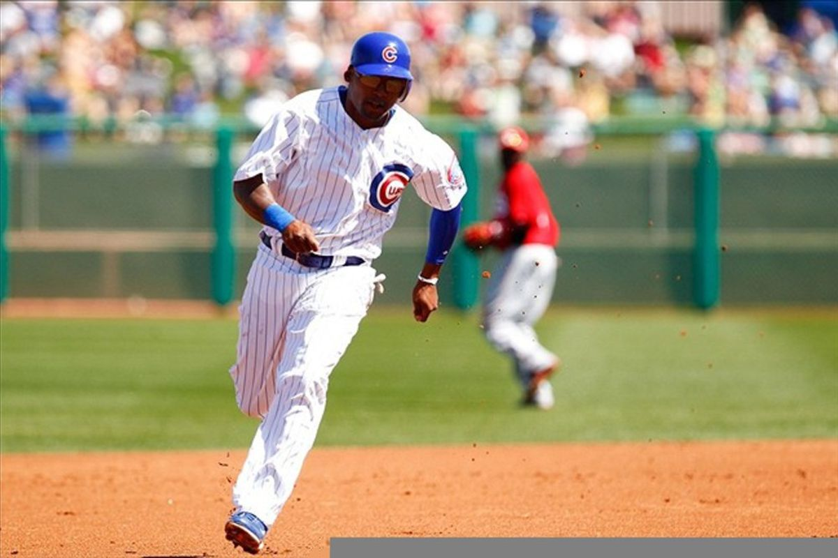 Chicago Cubs center fielder Marlon Byrd rounds the bases during the first inning against the Cincinnati Reds at HoHoKam Park. Credit: Debby Wong-US PRESSWIRE