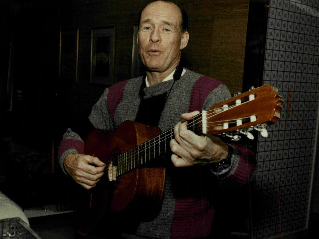 Patrick H .Arbor in 1993 with an acoustic guitar he used to play Italian folk tunes. File Photo.
