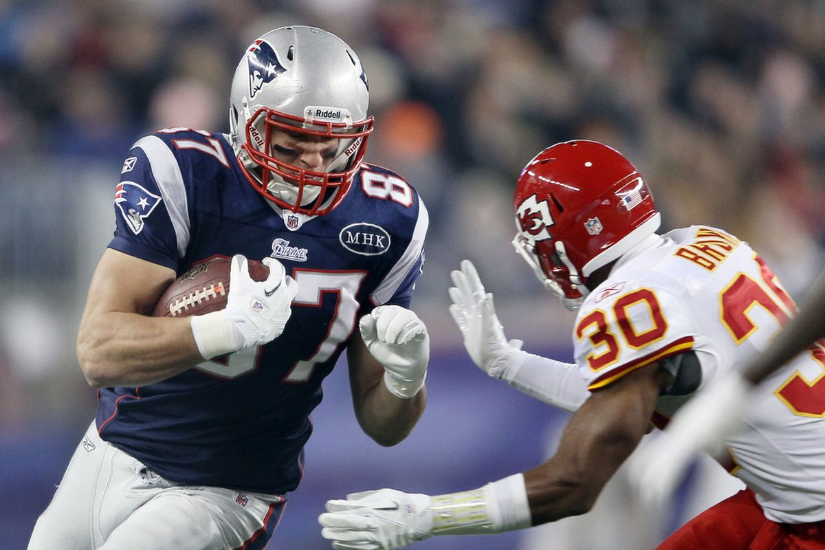 FOXBORO, MA - NOVEMBER 21:   Rob Gronkowski #87 of the New England Patriots carries the ball as  Jalil Brown #30 of the Kansas City Chiefs defends on November 21, 2011 at Gillette Stadium in Foxboro, Massachusetts.  (Photo by Elsa/Getty Images)