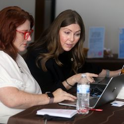 Mountain Heights Academy Middle School Principal Emily Andersen and Principal DeLaina Tonks read reviews for in-person orientation at the online school based in West Jordan on Tuesday, Aug. 24, 2021. Ninety percent of the respondents said they were very happy with the process and 10% said they were happy.