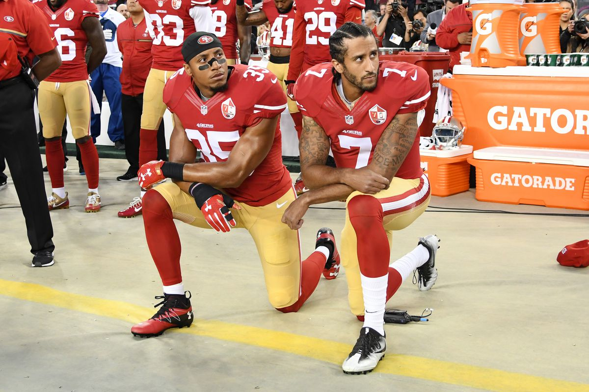 Eric Reid and Colin Kaepernick kneel during the national anthem