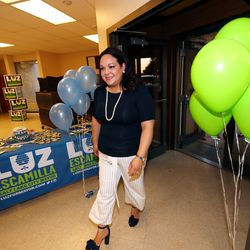 Salt Lake City mayoral candidate Luz Escamilla walks back into a primary election party after doing an interview at the Utah State Fair[ark in Salt Lake City on Tuesday, Aug. 13, 2019.