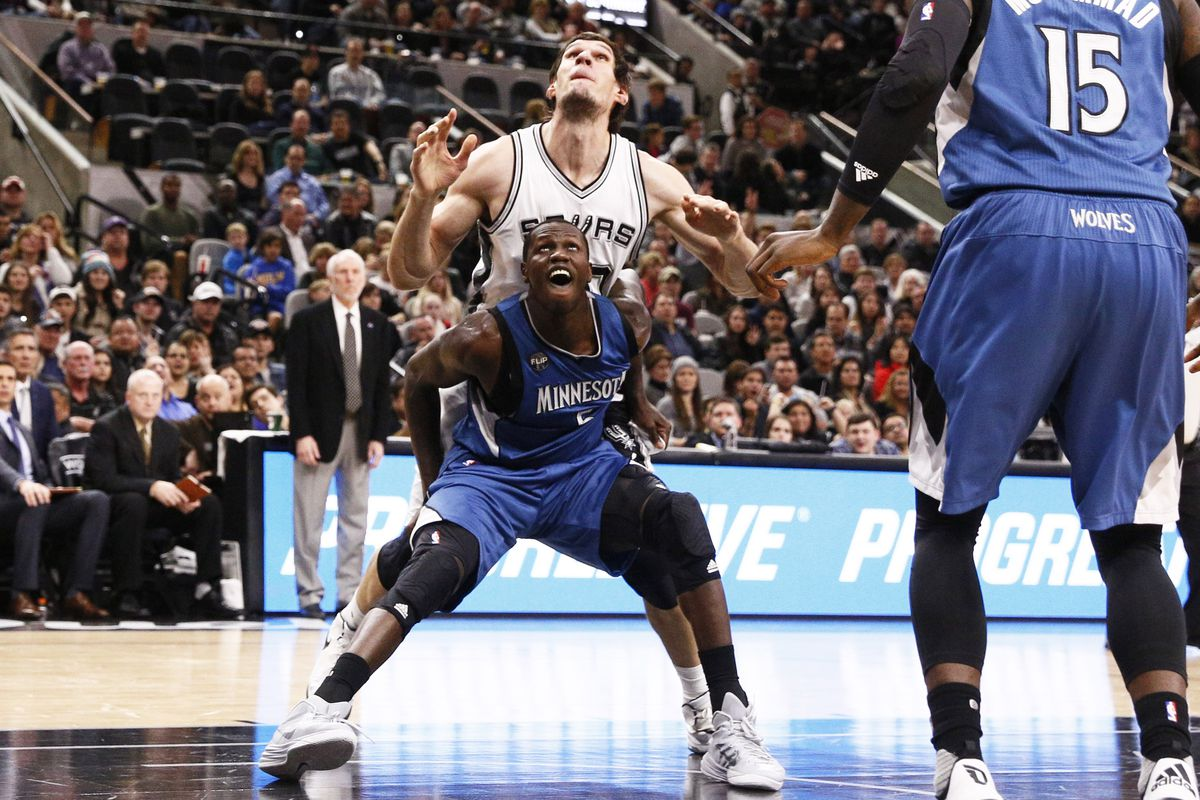Here, Boban is being boxed out by 6'11 Gorgui Dieng, whom he dwarfs.
