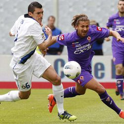 Fiorentina's Alessio Cerci, right, is challenged by Inter Milan's Lucio of Brazil during a Serie A soccer match at the Artemio Franchi stadium in Florence, Italy Sunday April 22, 2012.