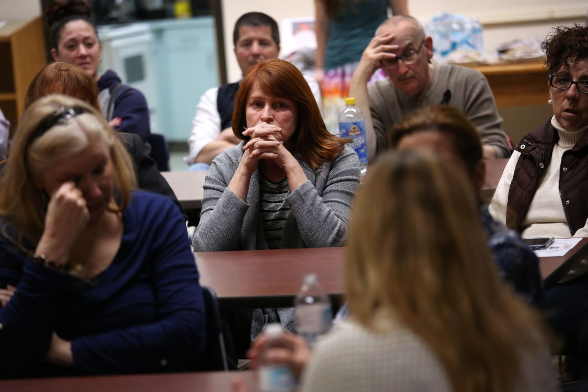 Family members of heroin and opioid addicts talk, as part of a support group, in Groton, Connecticut.