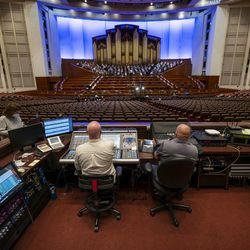 Technicians sit at their seats as the Tabernacle Choir at Temple Square rehearses at the Conference Center in Salt Lake City on Tuesday, Sept. 21, 2021. It was the choir's first rehearsal in more than 18 months.