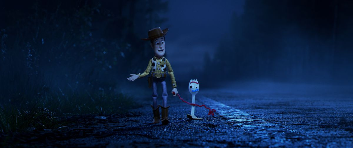Woody (Tom Hanks) and Forky (Tony Hale) on the road in the middle of the night.