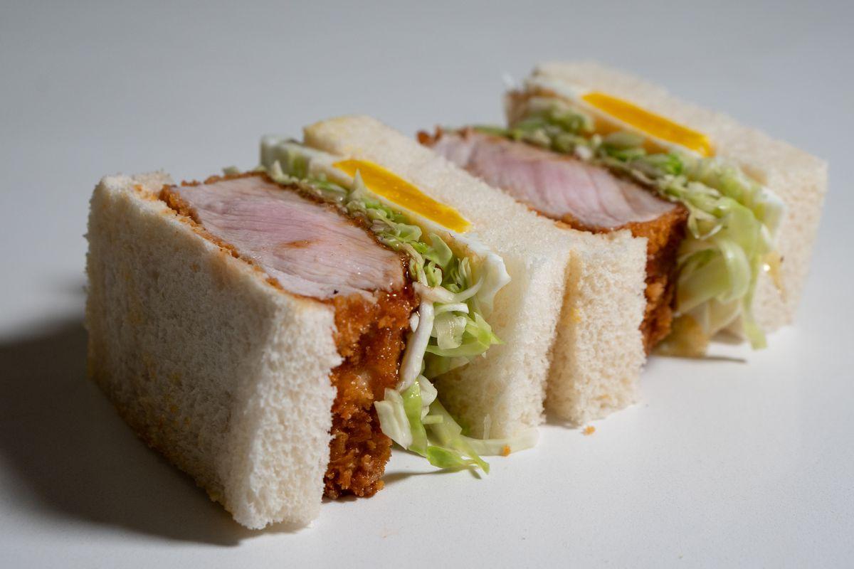 A Japanese-style pork katsu sando on its side.