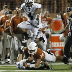 Backup quarterback David Ash #14 of the Texas Longhorns is brought down in the fourth quarter by defensive back Daniel Sorensen #9 of the BYU Cougars as BYU linebacker Uona Kaveinga #4 hurdles on September 10, 2011 at Darrell K. Royal-Texas Memorial Stadium in Austin, Texas.  (Photo by Erich Schlegel/Getty Images)