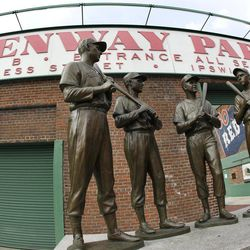 """The """"Teammates"""" statue is seen at the entrance to Gate B at Fenway Park in Boston Monday, April 9, 2012. The Boston Red Sox baseball home opener is Friday, April 13, 2012."""