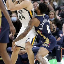 Utah Jazz forward Bojan Bogdanovic (44) looks to make a pass around New Orleans Pelicans guard Nickeil Alexander-Walker (6) during a preseason NBA game at the Vivint Smart Home Arena in Salt Lake City on Monday, Oct. 11, 2021. The Jazz won 127-96.