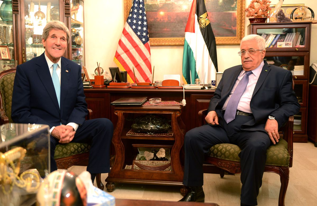 US Secretary of State John Kerry meets with Palestinian leader Mahmoud Abbas in 2014 (Thaer Ghanaim/PPO/Getty Images)