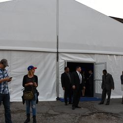 5:02 p.m. Security at the entrance to the Ricketts private party tent, on Addison across from Wrigley Field -