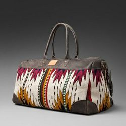 """<a href=""""http://www.revolveclothing.com/DisplayProduct.jsp?product=WLEA-UA3&c=""""> Will Leather Goods Oaxacan duffle</a>, $385, revolveclothing.com"""