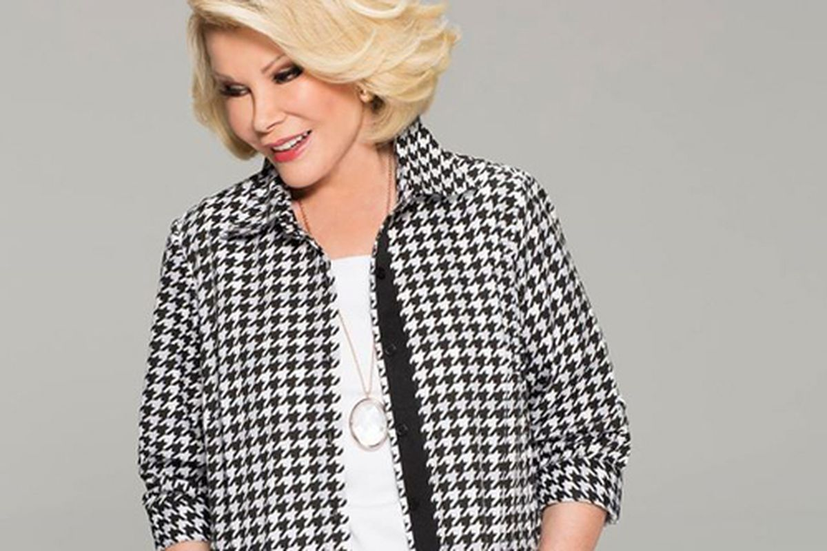 """Joan Rivers modeling a jacket from her QVC collection. Image via <a href=""""https://www.facebook.com/joanrivers/photos/pb.144568223039.-2207520000.1409928070./10152388272678040/?type=3&amp;theater"""">Facebook</a>"""