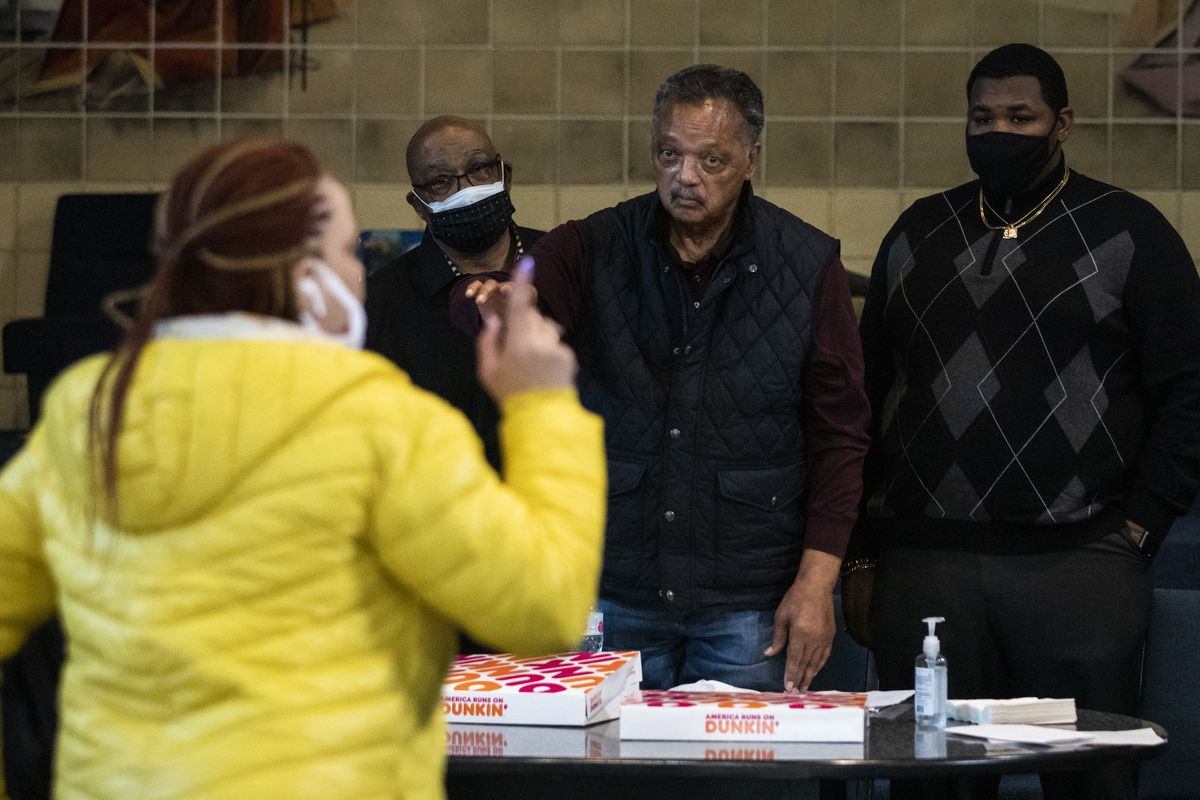 Rev. Jesse Jackson and members of the Rainbow PUSH Coalition mediate a meeting Tuesday between residents of Concordia Place Apartments, a representative from the U.S. Department of Housing and representatives from Capital Realty Group, the New York-based owners of the apartment complex located at 13037 S. Daniel Dr. on the Far South Side.