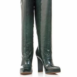 """<a href=""""http://www.matchesfashion.com/product/161582"""">Leather knee-high boots by Maison Martin Margiela</a>, $259.60 (were $1,083)"""
