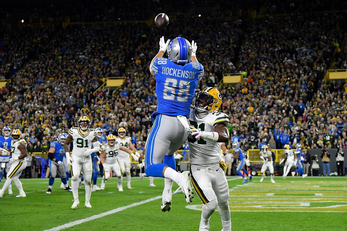 T.J. Hockenson of the Detroit Lions can't complete the pass in the end zone in the second quarter against Adrian Amos of the Green Bay Packers at Lambeau Field on October 14, 2019 in Green Bay, Wisconsin.