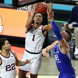 Gonzaga Bulldogs guard Jalen Suggs (1) goes at the hoop with Brigham Young Cougars center Richard Harward (42) defending as BYU and Gonzaga play in the finals of the West Coast Conference tournament at the Orleans Arena in Las Vegas on Tuesday, March 9, 2021. Gonzaga won 88-78.