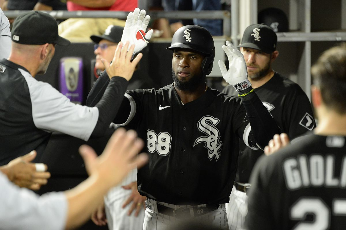 Luis Robert #88 of the Chicago White Sox celebrates with teammates after hitting a solo home run in the second inning against the Los Angeles Angels on September 14, 2021 at Guaranteed Rate Field in Chicago, Illinois.