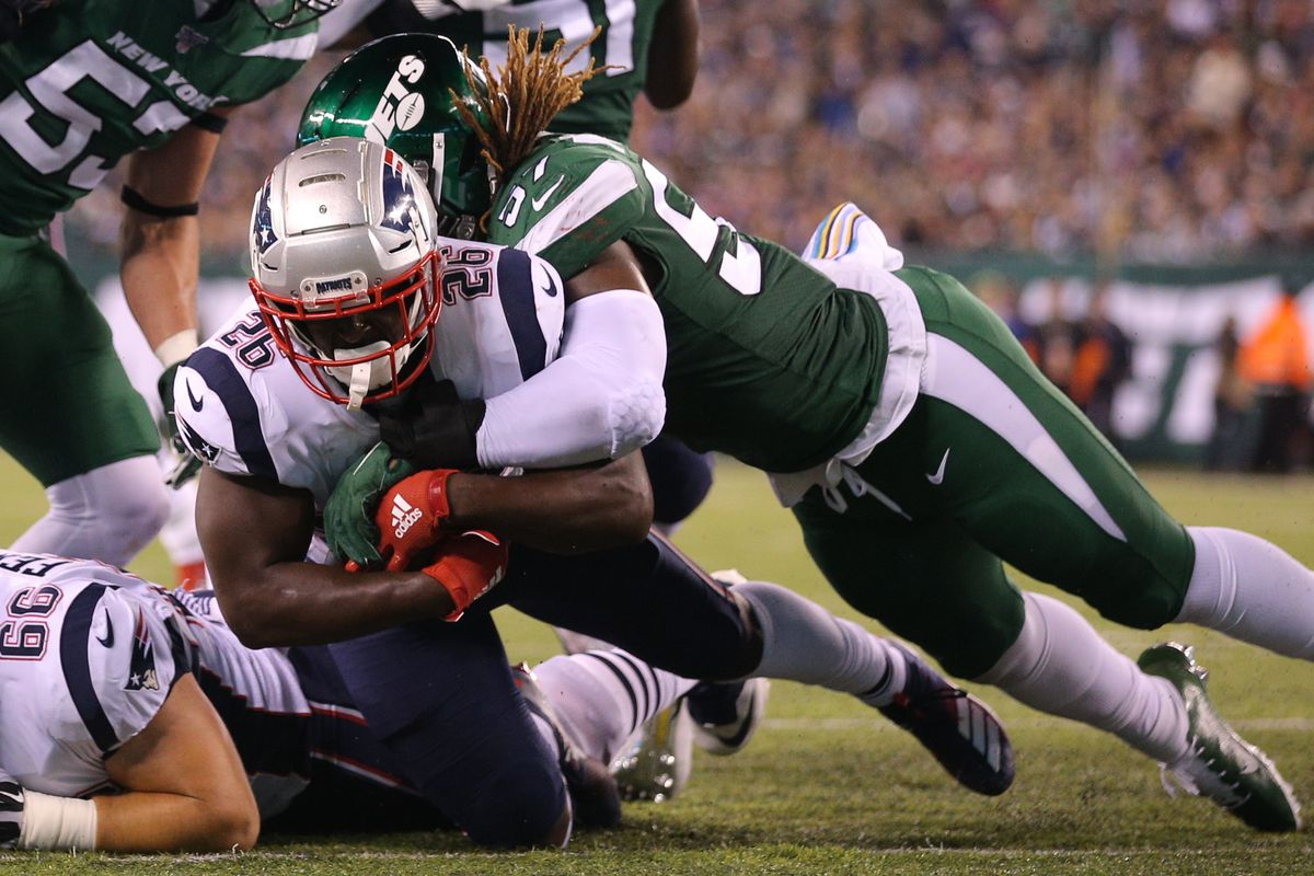 New England Patriots running back Sony Michel dives for a touchdown against New York Jets linebacker C.J. Mosley during the second quarter at MetLife Stadium.
