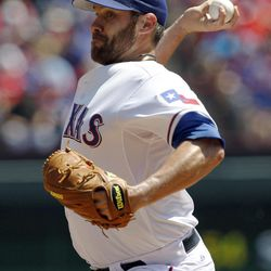 Texas Rangers starting pitcher Colby Lewis delivers the ball against the Chicago White Sox during the first inning of a baseball game Friday, April 6, 2012 in Arlington, Texas.