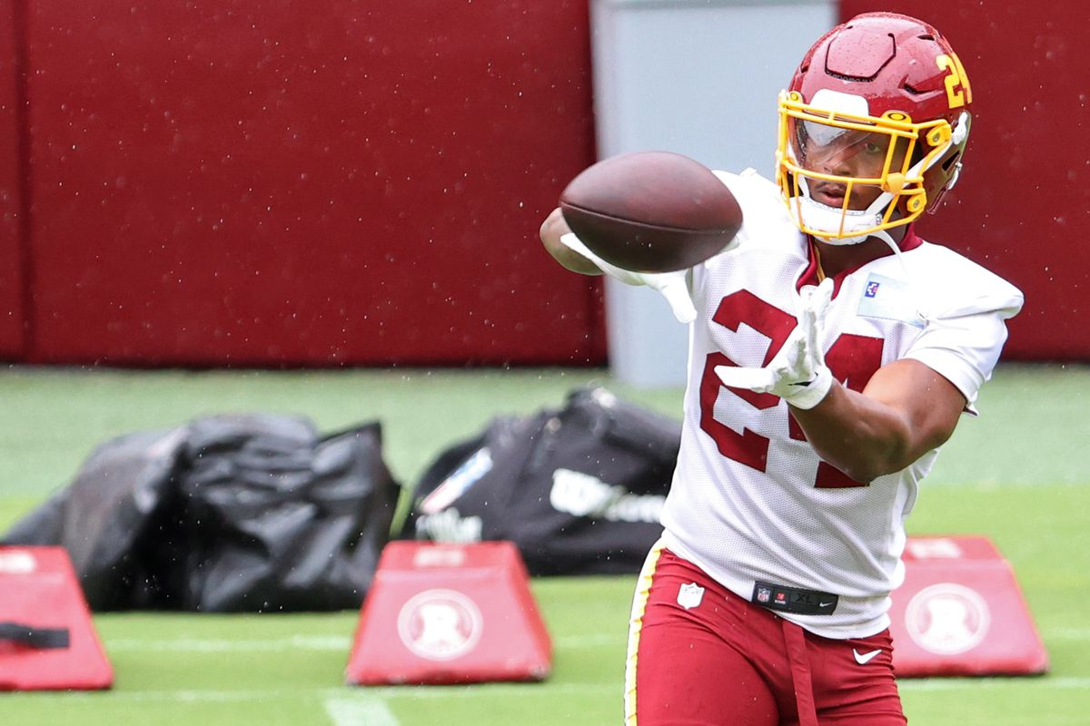 Aug 31, 2020; Washington, DC, United States; Washington Football Team running back Antonio Gibson (24) catches a pass during a practice at Fedex Field.