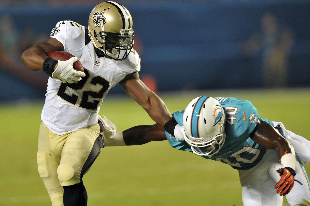 Mark Ingram does the Heisman pose during a pre-season game vs. the Dolphins.