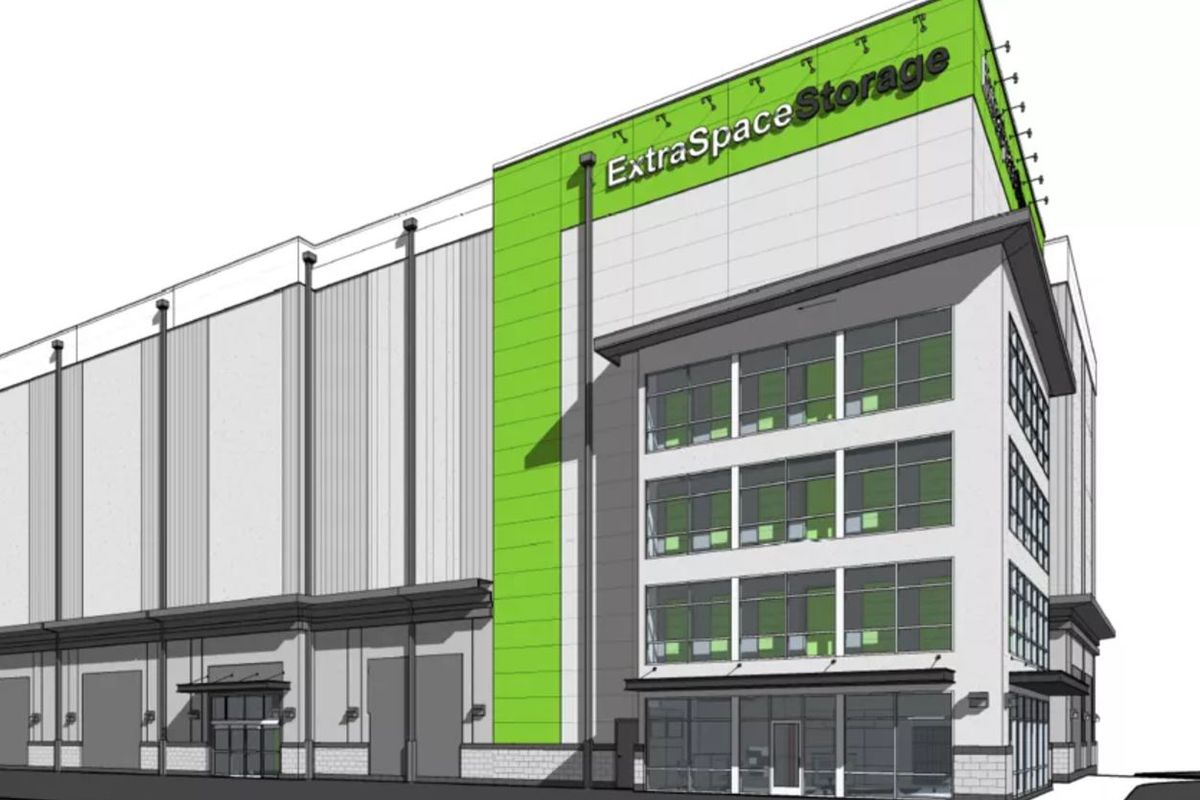 A rendering of a five-story storage facilty with blank white walls and green accents, with windows at the corner.