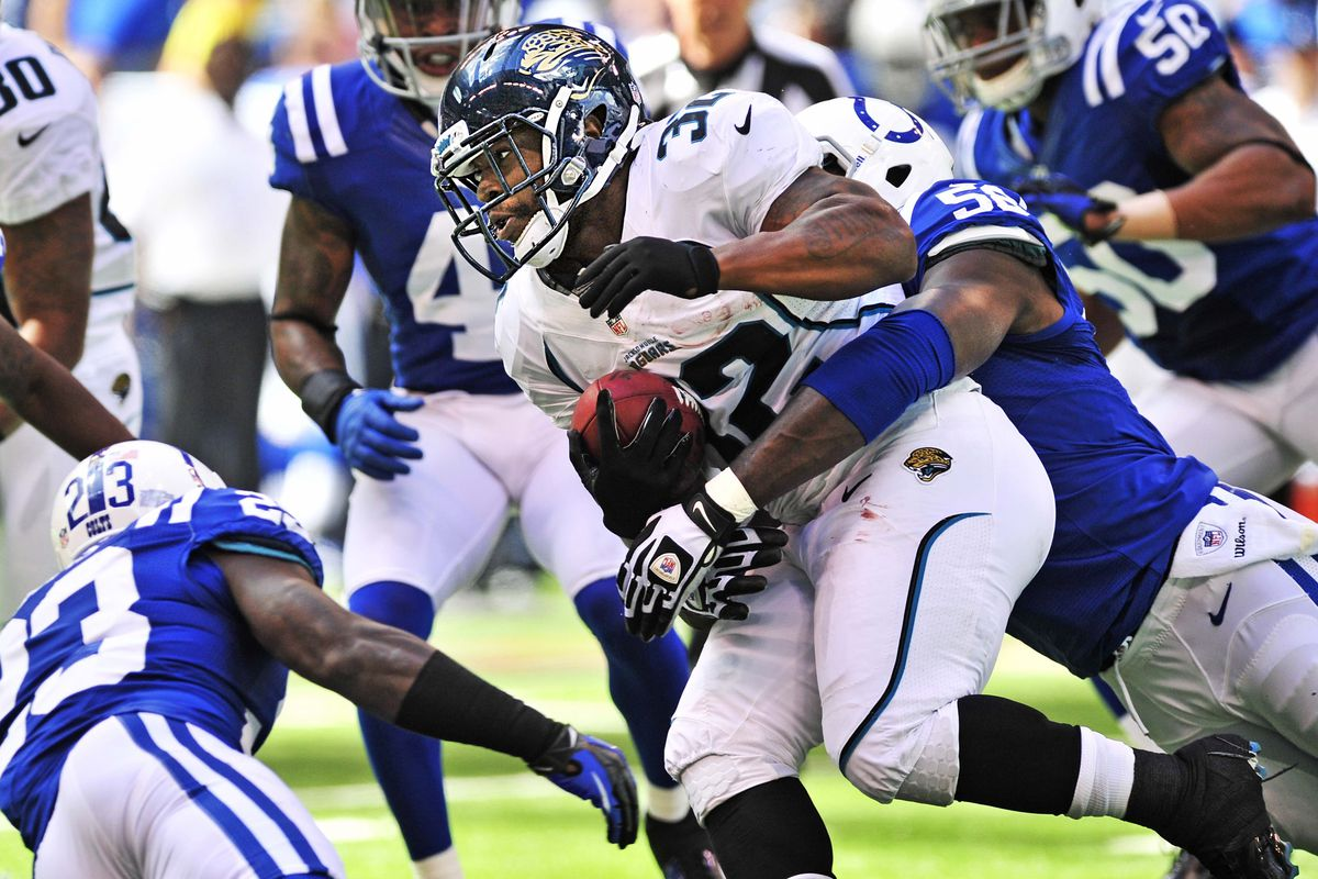 Sept. 23, 2012; Indianapolis, IN, USA;   Jacksonville Jaguars  running back Maurice Jones-Drew (32) carries the ball during first half against the Indianapolis Colts at Lucas Oil Stadium. Mandatory Credit: Thomas J. Russo-US PRESSWIRE