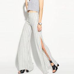 """<b>Reformation</b> Peru Pants in Stripe, <a href=""""http://thereformation.com/PERU-PANTS-STRIPE.html"""">$148</a>"""