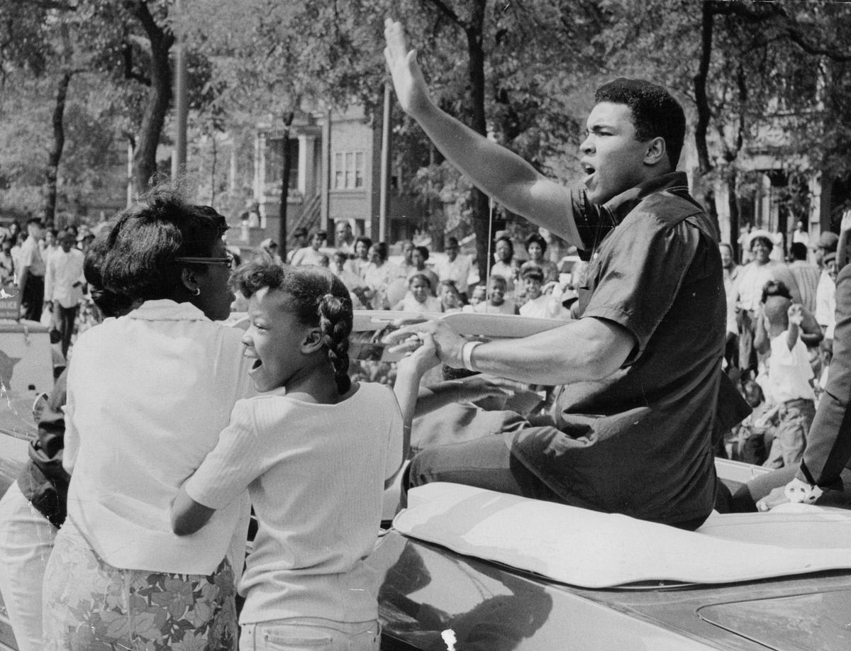 Heavyweight boxing champ Cassius Clay (aka Muhammad Ali) rides in the Bud Billiken parade on the South Side in 1966.