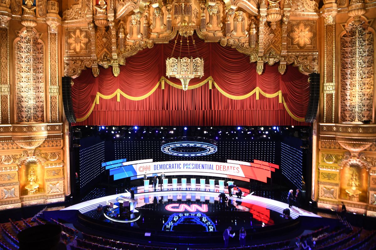 The stage gets prepped for the Democratic debates with podiums and video screens at the ornate Fox Theatre in Detroit