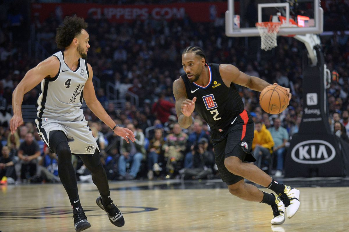 Los Angeles Clippers forward Kawhi Leonard moves the ball against San Antonio Spurs guard Derrick White during the second half at Staples Center.