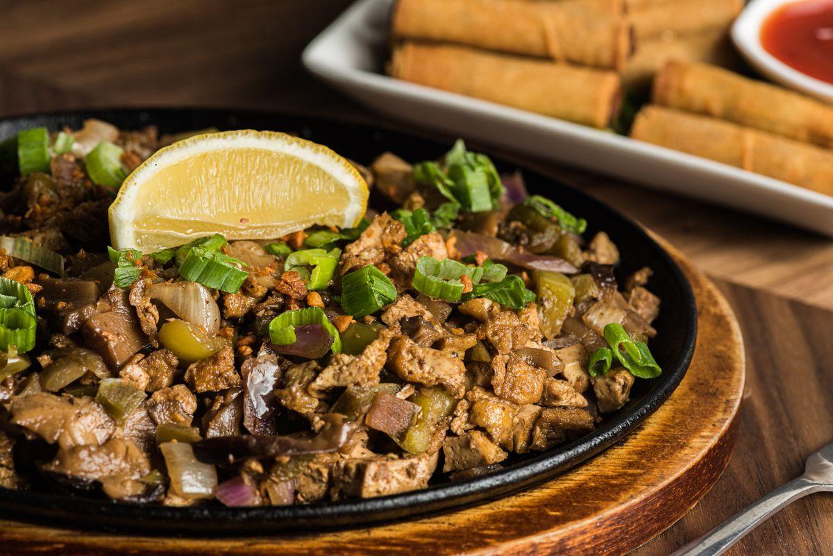 Tofu and mushroom sisig on a sizzling plate