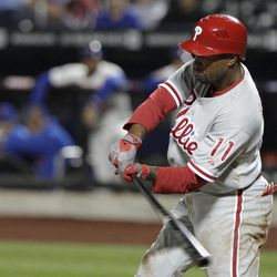Philadelphia Phillies' Jimmy Rollins hits a two-run single during the first inning of a baseball game against the New York Mets on Thursday, Sept. 20, 2012, in New York.