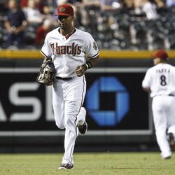 An injured Arizona Diamondbacks' Chris Young, left, leaves the field and is replaced by Gerardo Parra (8) during the first inning of a baseball game against the San Diego Padres on Tuesday, Sept. 18, 2012, in Phoenix.