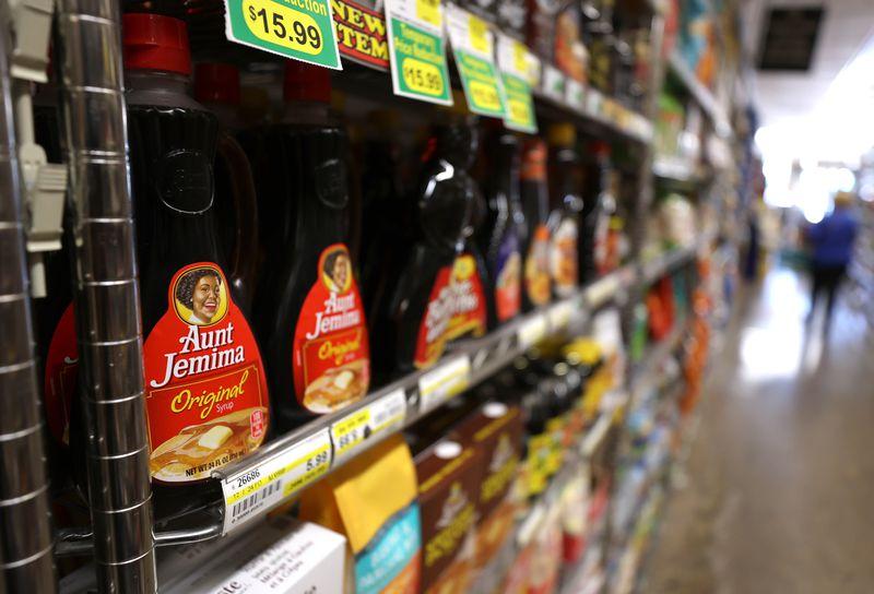 Bottles of Aunt Jemima on grocery store shelves.